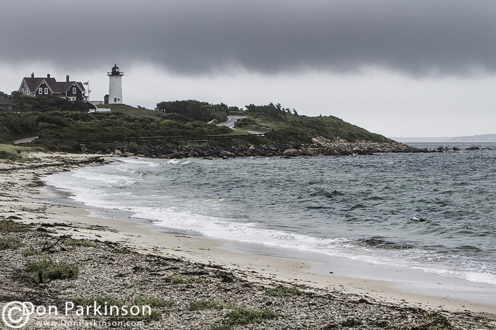 Dark clouds hver over Nobska Light in Falmouth MA.