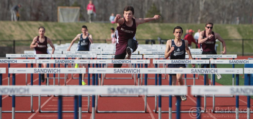 Falmouth Jack Koss takes first the men's 100m hurdles during the Sandwich vs. Falmouth track meet at Sandwich High School Wednesday afternoon.